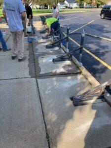 Concrete sidewalk work at GMS