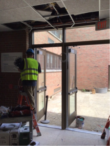 Day Automation works on the door security in the new curtain walls on Aug. 6, 2021.