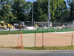 Rolling out the artificial turf at the softball field Sept. 23, 2020.